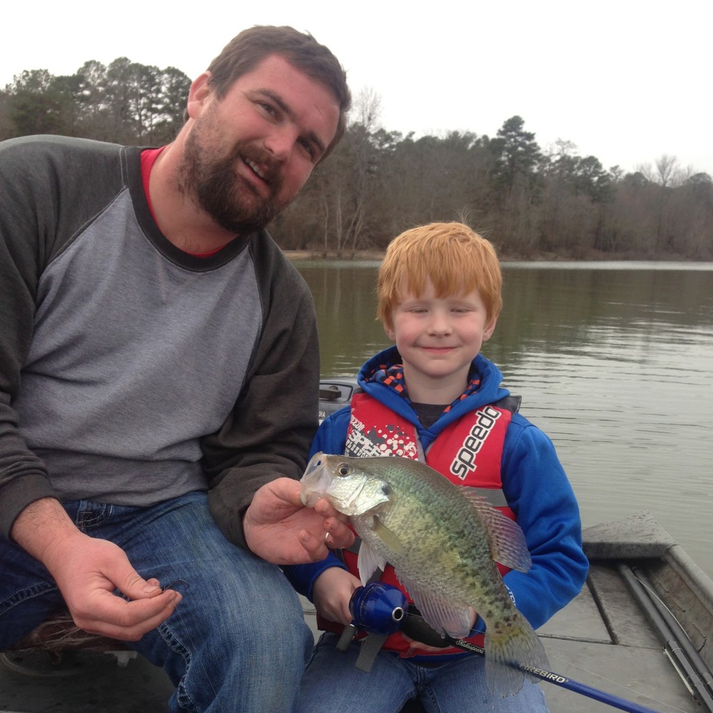 Only In Arkansas - My husband Aaron and our son Evan holding Crappie