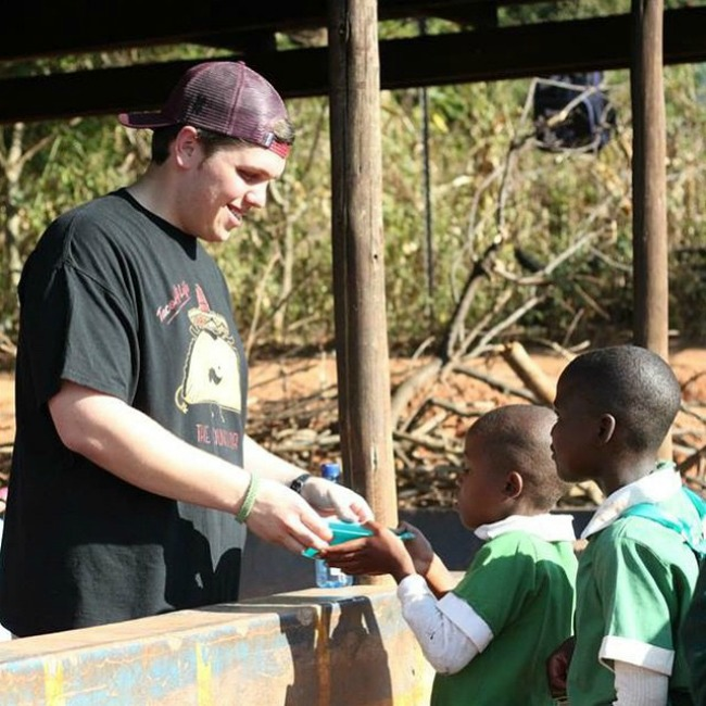Justin serving the kids in Swaziland