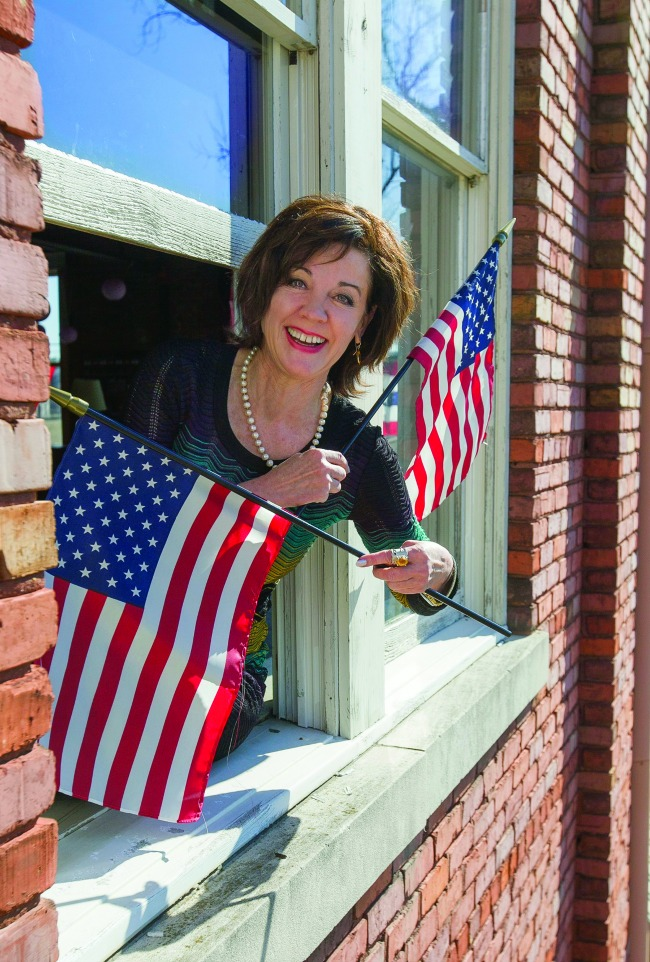 Arkansas Democrat-Gazette/BENJAMIN KRAIN --2/10/15-- Kerry McCoy, owner and president of Arkansas' Flag and Banner was the recipient of the Betsy Ross Award from the National Independent Flag Dealers Association (NIFDA). FlagandBanner.com started as a one-woman company with McCoy handling all aspects of the business. That small flag business has grown to become a multi-million dollar success located in downtown Little Rock at 800 West 9th Street and now employs a staff of 25.