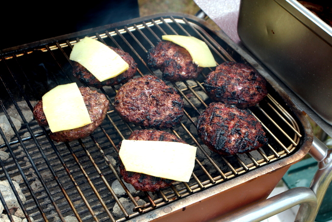 Hamburgers being grilled on a PK Grill