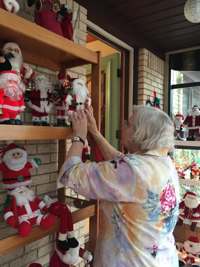 Santa Lady Fixing Santas