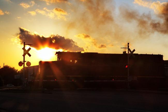 Train Crossing at Sunrise