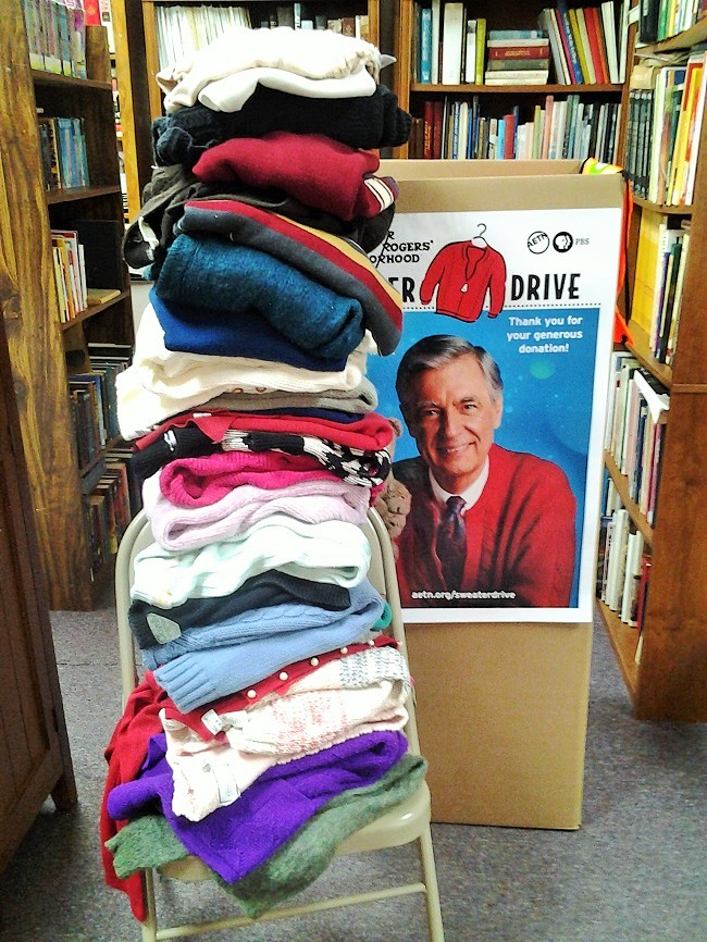Sweaters, boxes, and books in our library (2)