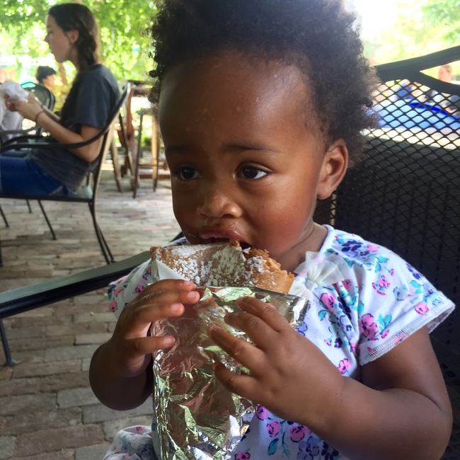 toddler eating crepe