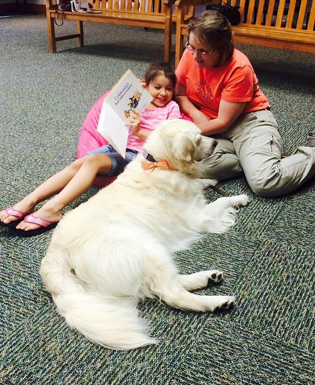 girl and white dog
