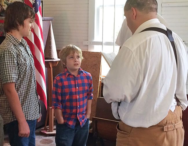 Experiencing a spelling bee in a one-room schoolhouse