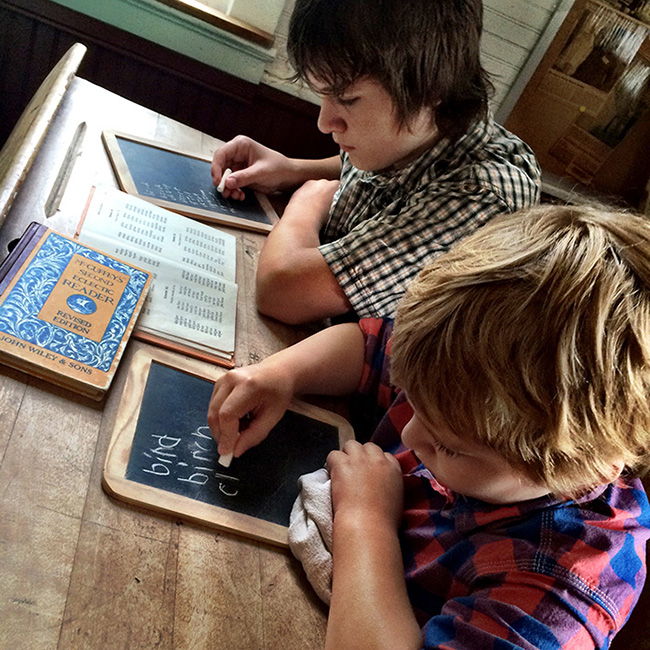 Writing spelling words on a slate