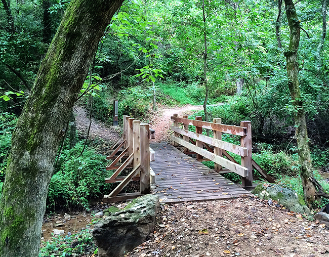 bridge-and-dirt-trail-along-lake-atalanta-paved-trail
